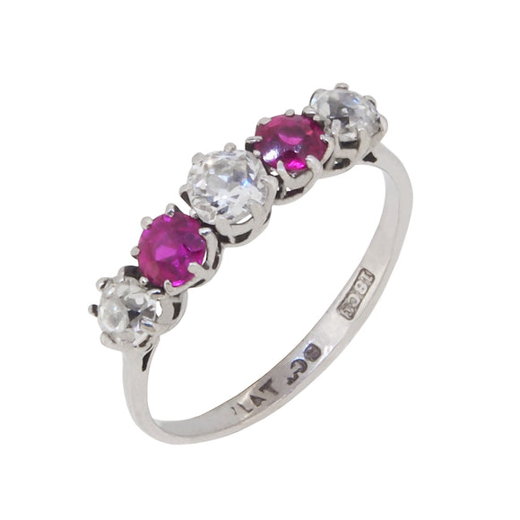 An early 20th century, 18ct white gold & platinum setting, ruby & diamond set half hoop ring