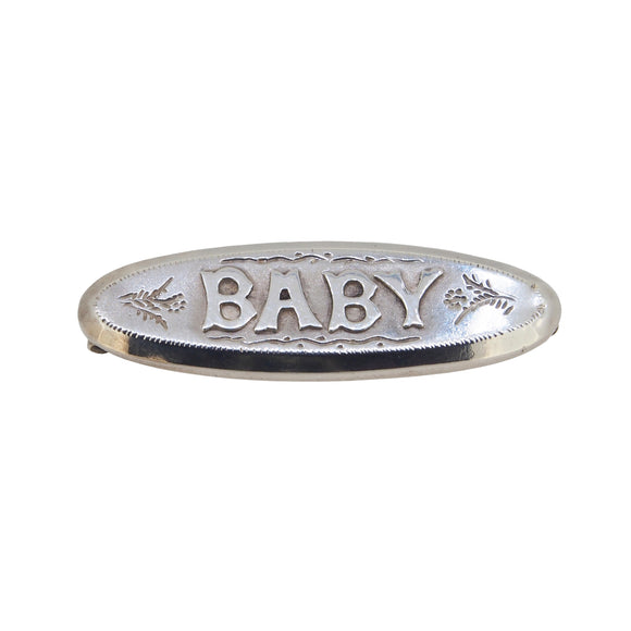 An Edwardian, silver, sweetheart style bar brooch with the word Baby