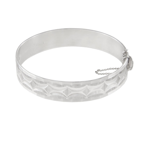 A modern, silver, fully engraved, diamond cut, hinged bangle