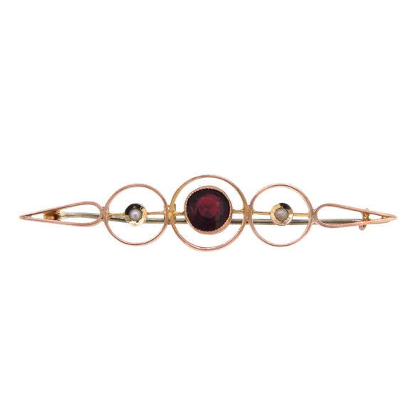 An Edwardian, 9ct yellow gold, garnet & pearl set bar brooch