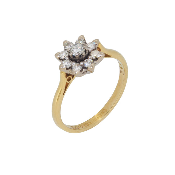 A mid 20th century, 18ct yellow gold, diamond set, daisy style cluster ring