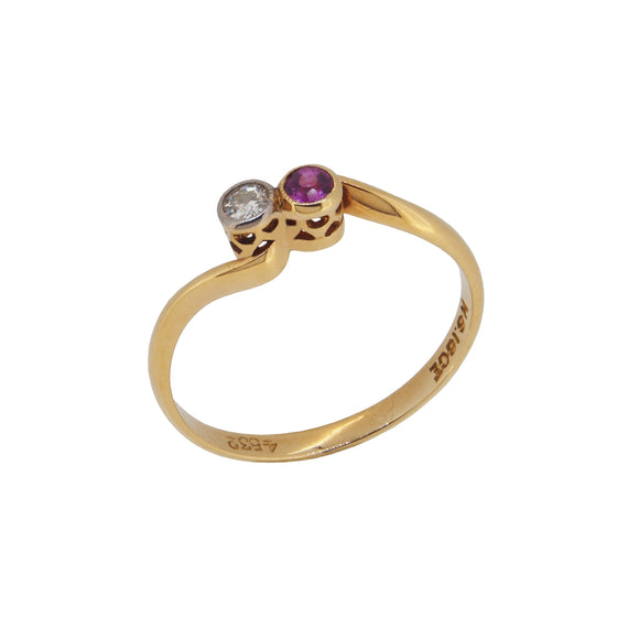 An early 20th century, 18ct yellow gold, ruby & diamond set crossover ring