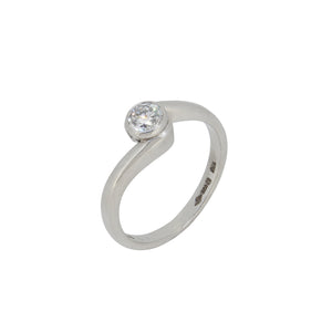 A modern, platinum, diamond set, single stone crossover ring