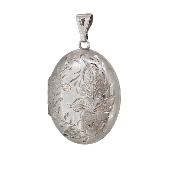 A modern, silver, engraved, oval locket