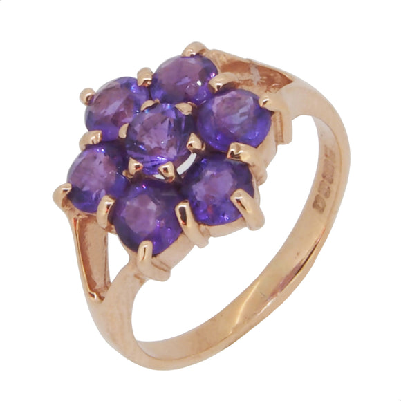 A modern, 9ct yellow gold, amethyst set cluster ring