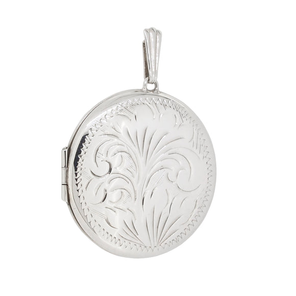 A modern, silver, engraved, circular locket