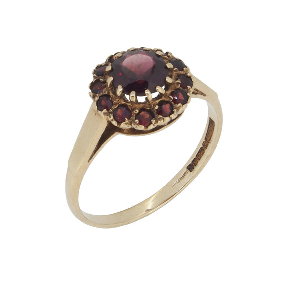 A modern, 9ct yellow gold, garnet set cluster ring