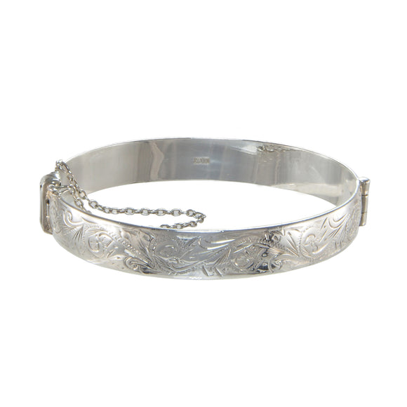 A modern, silver, half engraved, narrow, hinged bangle
