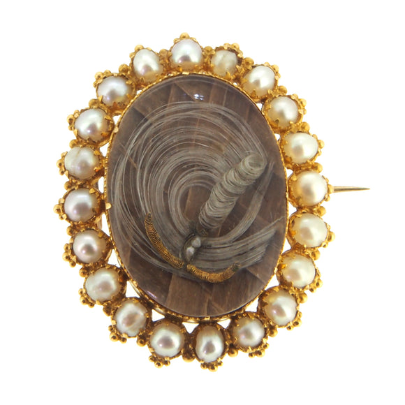 A Victorian, yellow gold, pearl set Mourning brooch with a central locket of hair