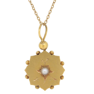 A Victorian, yellow gold, half pearl set, floral pendant & chain