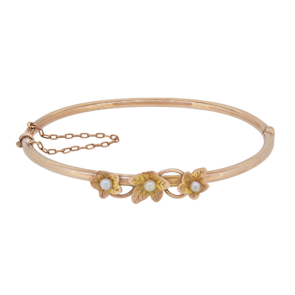 An Edwardian, yellow gold, pearl set, floral style bangle
