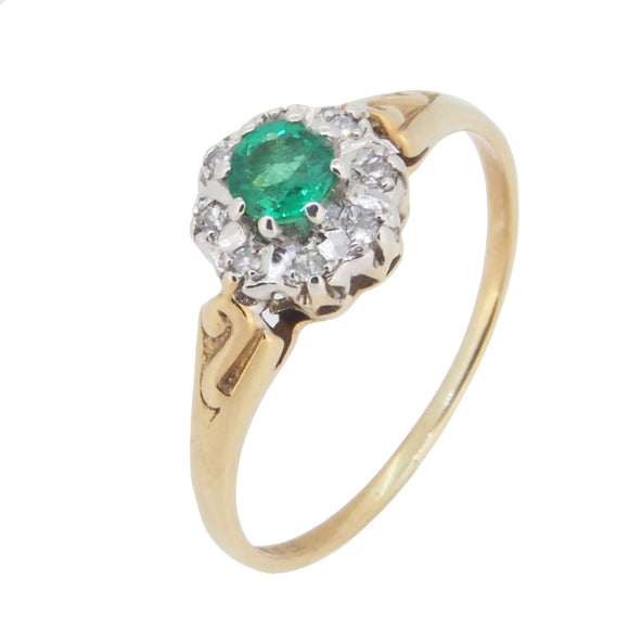 A modern, 9ct yellow gold, emerald & diamond set cluster ring.