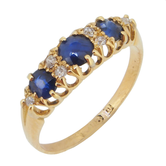 An Edwardian, 18ct yellow gold, sapphire & diamond set half hoop ring