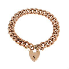 An early 20th century, 9ct rose gold, hollow curb link padlock bracelet