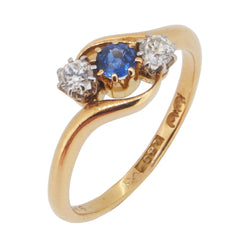 An early 20th century, 18ct yellow gold, sapphire & diamond set, three stone crossover ring