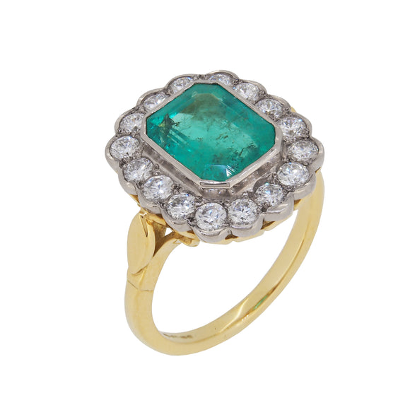 An 18ct yellow gold, emerald & diamond set cluster ring