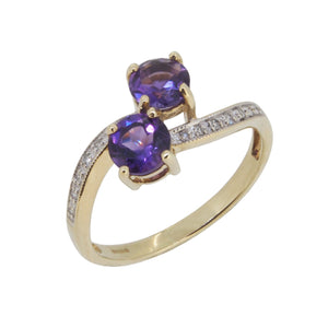 A modern, 9ct yellow gold, amethyst & diamond set crossover ring