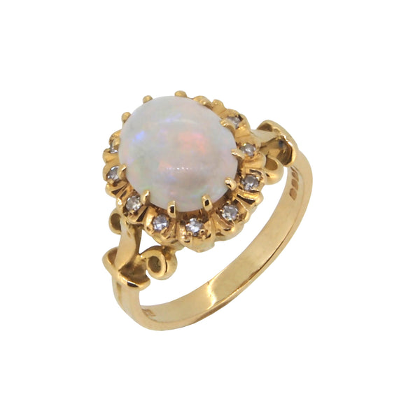 A modern, 18ct yellow gold, opal & diamond set cluster ring