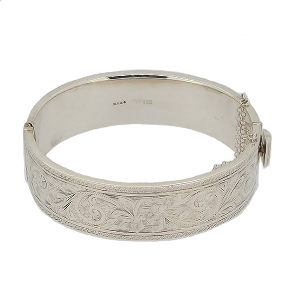 A modern, silver, hollow, engraved, hinged bangle