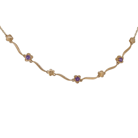 A modern, 9ct yellow gold, amethyst set floral neck collar