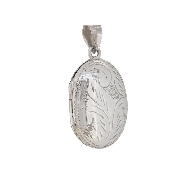 A modern, silver, engraved oval locket