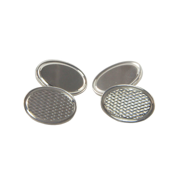 A pair of modern, silver, engine turned oval cufflinks