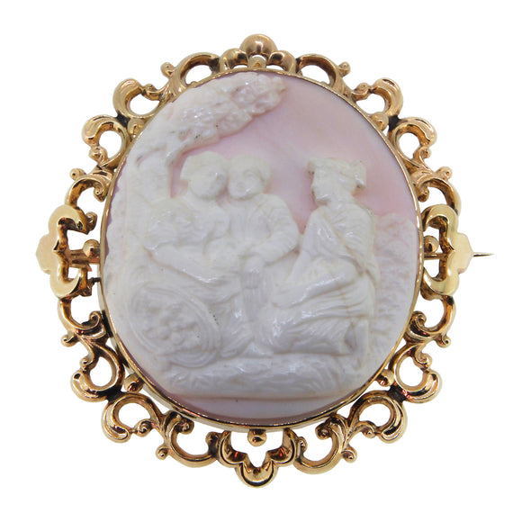 A Victorian, yellow gold, ornate Cameo brooch, depicting three people under a tree