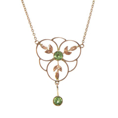 An Edwardian, 9ct rose gold, peridot set pendant & chain