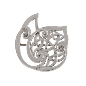 A modern, silver, abstract brooch