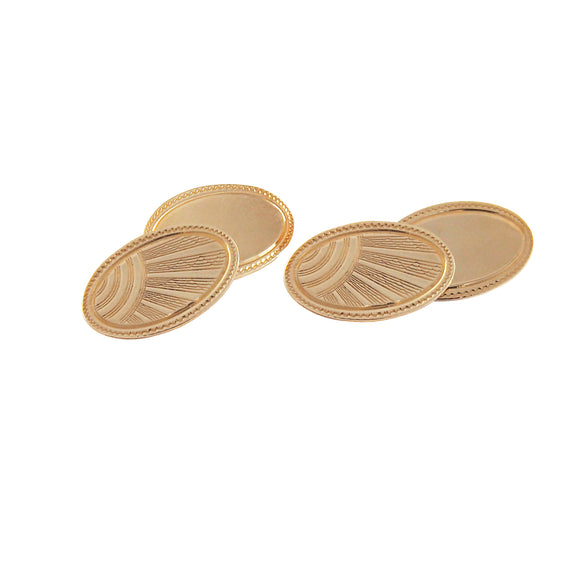 A pair of mid 20th century, 9ct yellow gold oval cufflinks