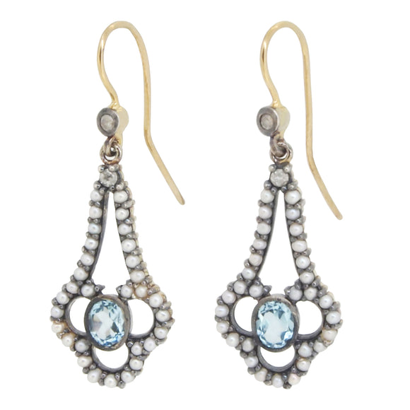 A pair of modern, yellow gold, blue topaz & seed pearl set drop earrings