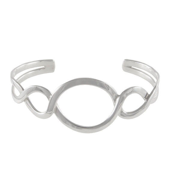A modern, silver, open, figure of eight bangle