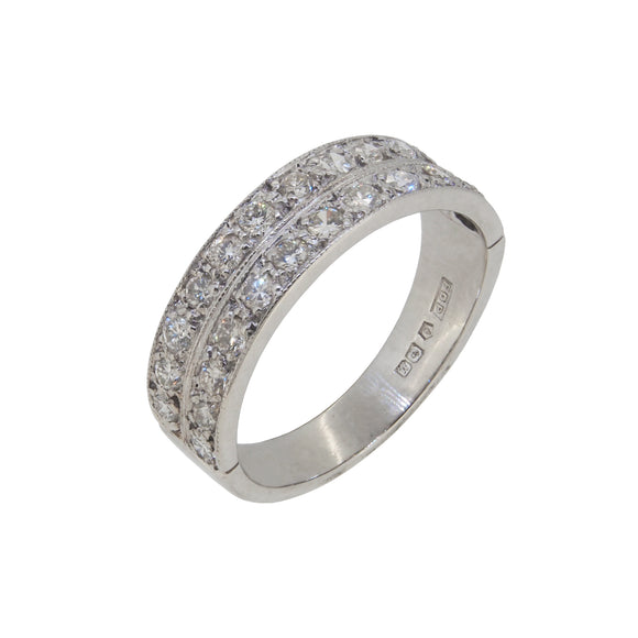 A modern, platinum, diamond set, two row, half eternity ring