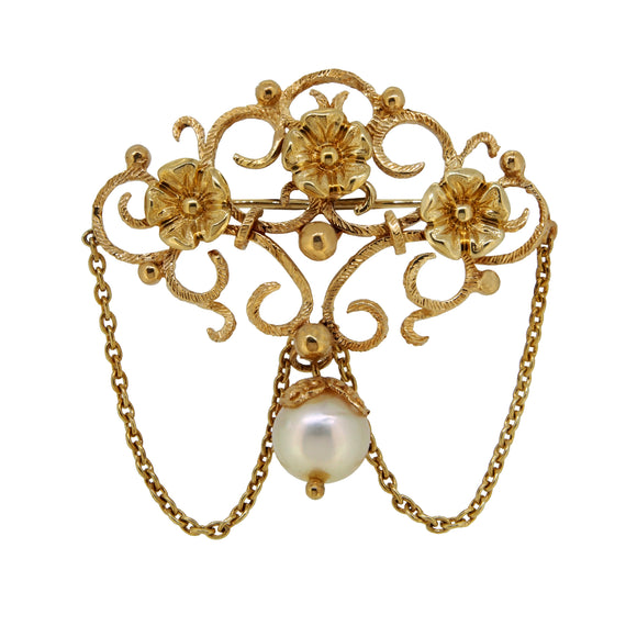 A modern, 14ct yellow gold, pearl set, open scroll, floral style brooch