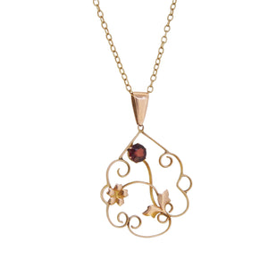 An Edwardian, 9ct rose gold, garnet set pendant & chain