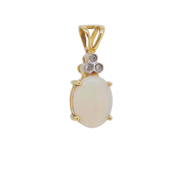 A modern, 18ct yellow gold, opal & diamond set pendant