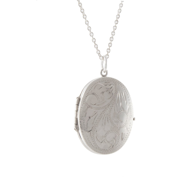 A mid 20th century, silver, engraved, oval locket & chain