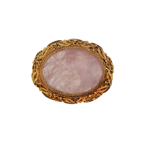 An early 20th century, silver & silver gilt, rose quartz set brooch