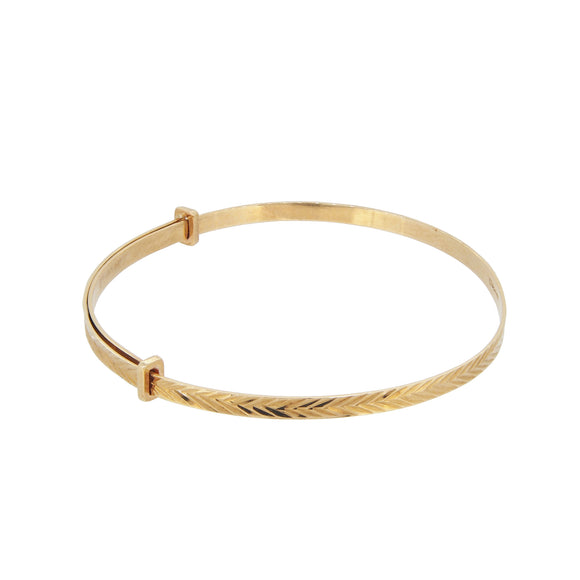 A modern, 9ct yellow gold, expanding, child's bangle