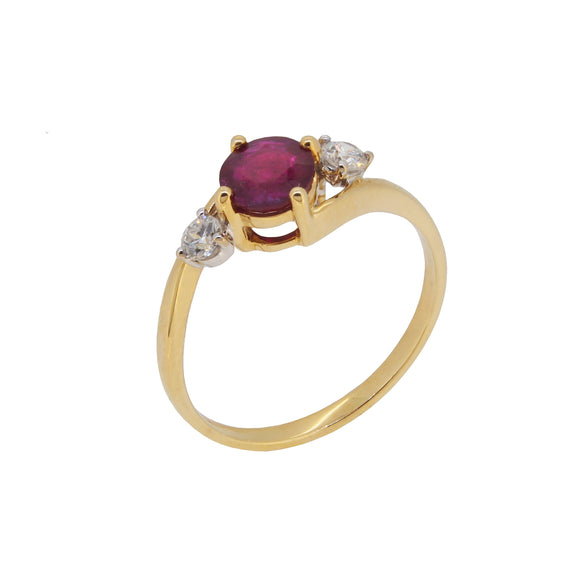 A modern, 18ct yellow gold, ruby & diamond set, three stone crossover ring