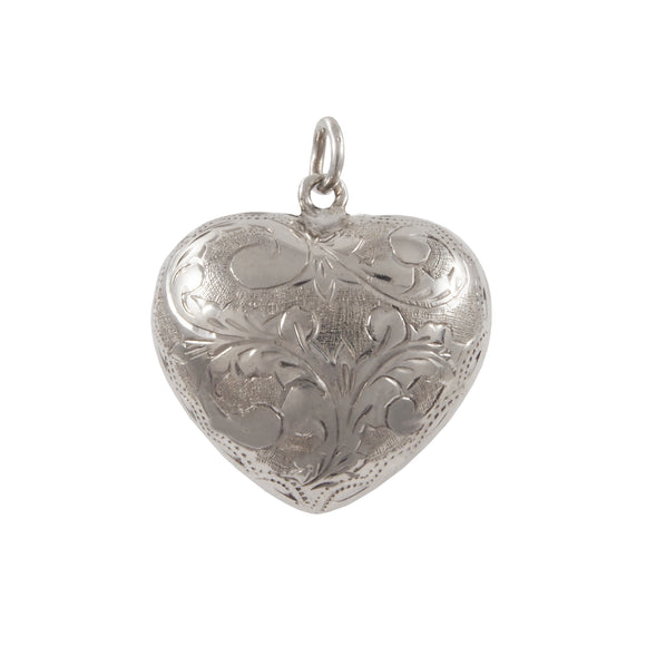 A modern, silver, fully engraved, heart shaped pendant