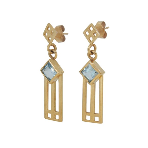 A pair of modern, yellow gold, blue topaz set, Rennie Mackintosh style drop earrings