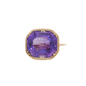 An early 20th century, yellow gold, amethyst set brooch