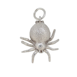 A silver, spider charm pendant