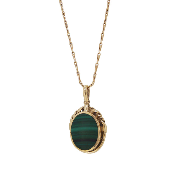 A modern, 9ct yellow god, malachite set oval pendant & chain