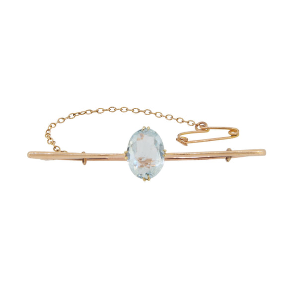 An Edwardian, 9ct yellow gold, oval aquamarine set bar brooch