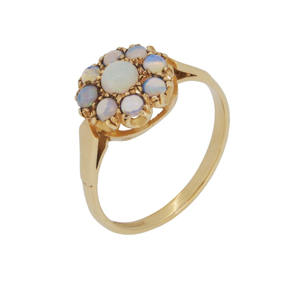 A mid 20th century, 9ct yellow gold, opal set, circular, nine stone cluster ring