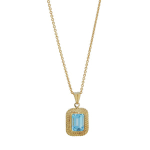 A modern, 9ct yellow gold, blue topaz set pendant & chain