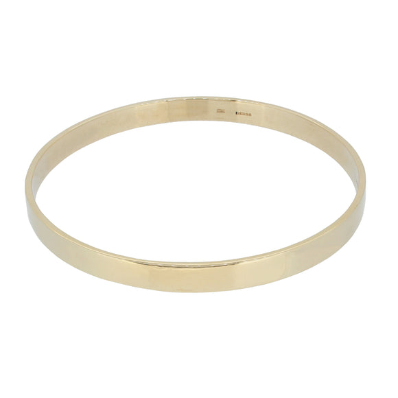 A modern, 9ct yellow gold, flat bangle
