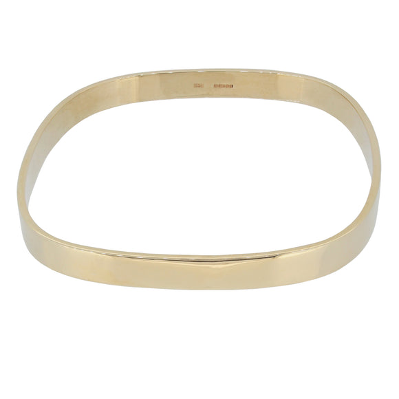 A modern, 9ct yellow gold, square bangle
